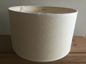 Contemporary style cream coloured round lamp shade with trim