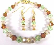 Bracelet and Earrings Adorned with  Champagne and Green Swarovski Crystals
