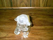 Solid glass candle holder with a solid glass bear in front of a votive candle ho