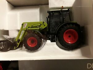 Class Axos 330 + FL 100 - Traktor -  1:32 Schuco