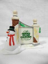 "Department 56 Heritage Village Collection., ""Village Sign w/ Snowman"", 5572-7"