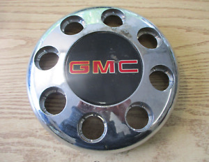 One 1995 to 1999 GMC 3500 dullay chrome plastic bolt on front center cap hubcap