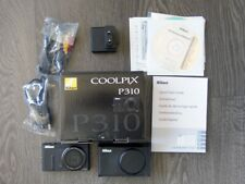 NIKON COOLPIX P310 as new in box with 8Gb SD and leather case.