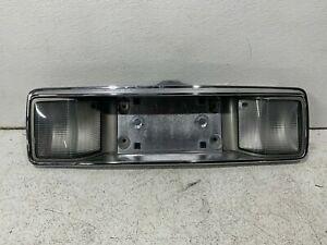 1997-1999 Cadillac DeVille rear garnish panel license plate frame 16518167 oem