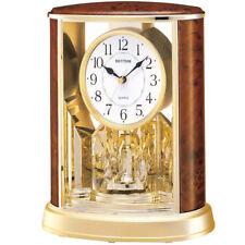 Rhythm 7724/20 Tischuhr Quarz analog mit Drehpendel golden