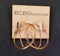 "BCBGeneration Rose Gold Inter-looping oval and round 1 1/2"" hoop earrings"