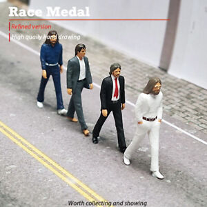 Racemedal 1:64 figure of a small man in the scene of a car crossing the street