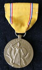 WORLD WAR II MILITARY METAL & RIBBON AMERICAN DEFENSE DATED 1937 & 1941