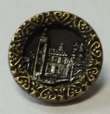 Small vintage metal picture button, castle or building