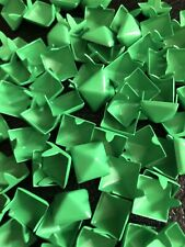 100 count bag of fluorescent green pyramid studs.