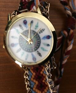 Ladies Unusual Feathers Dial Watch With Decorative Braided Style Bracelet Strap.