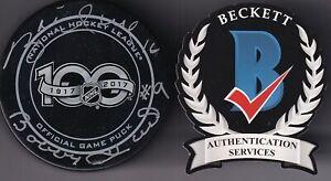 BECKETT BOBBY & BRETT HULL DUAL SIGNED NHL 100TH YEAR REAL GAME MODEL PUCK 81312