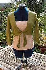 80% viscose, 20% nylon knit 3/4 sleeved, soft green shrug in vgc