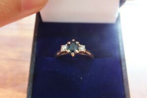 Vintage Solid 9ct gold Blue Sapphire with a green tinge and diamond ring
