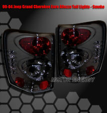 99-04 JEEP GRAND CHEROKEE REAR TAIL LIGHTS LIGHT SMOKE 2002 2003 2001 ORVIS 5.9