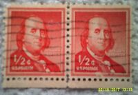 1955 Scott 1030 U. S. Benjamin Franklin two used 1/2 cent stamp off paper