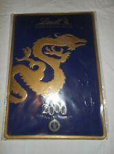 Lindt & Sprungli Inc. Dragon Tin Metal Advertisement Sign Signage 2000 Vintage