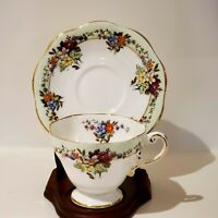 EB FOLEY TEACUP AND SAUCER MINT GREEN AND GOLD RIM DAISY BOUQUET