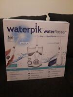 NEW OPENED BOX Waterpik Water Flosser Ultra And Cordless Plus With Attachments
