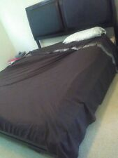 King size bed with matress, blk frame with leather in background squares