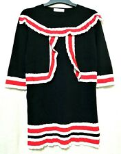 Black knit long top / mini dress with red and white ruffle trim