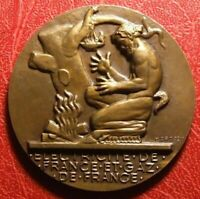 Art Deco men from fire quest to electricity medal by Henri Dropsy