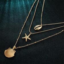 - gande - le coquillage. collier de coquille de multicouches plage de bijoux