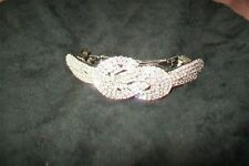 Unbranded-metal hair clip with crystals.New without tags.