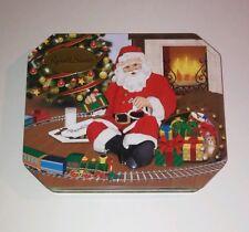 "Russell Stover Christmas Tin Santa Toys Trains Tree 10 1/16"" X 8 5/16"" X 1 5/8"""