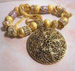 Beautiful one of a kind hand assembled necklace with gold tone beads & pendant