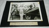 Vintage Photograph of Woman standing next to circus truck, Col. Tim McCoy's Wild