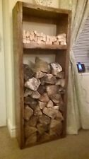 A tall hand-crafted Lehon log store with kindling shelf