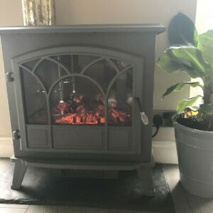 Electric stove fire In Grey From Dunelm Log Effect With Slate Hearth