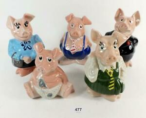 SET OF FIVE  NAT. WEST PIGGY BANKS  WITH ORIGINAL STOPPERS