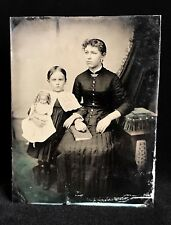 SUPER RARE 1/2 PLATE TINTYPE OF TWO SISTERS - THE YOUNGEST HOLDING A LARGE DOLL