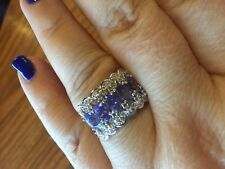 genuine Tanzanite and white ziricon Platinum over sterling silver ring