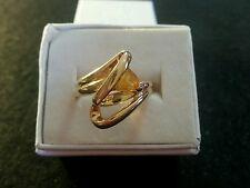 10k yellow gold serpentine ring w/triangle shape yellow stone size 6.75 (xfz)