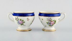 Sevres, France. Two antique cream cups in hand-painted porcelain. 19th C.