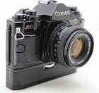 Canon A-1 vintage 35mm SLR camera, lens FD 50mm 1:1.8 & Power Winder A