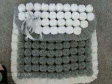 hand made baby blue and white pom pom//bobble blanket  approx 25 inch x 32inch