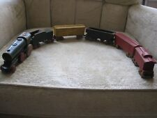 ANTIQUE WOODEN AND METAL RAILROAD TOY SET.