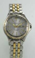Armitron Watch Mens Stainless Silver Gold Day Date 30m Water Res Battery Quartz