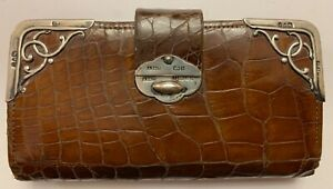 Silver and leather Art Nouveau purse, cards and stamp wallet.