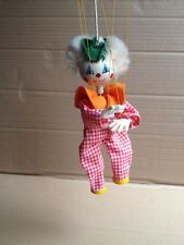 A toy is a clown. Moving on the ropes.