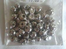 n. 40 Perline a forma di teschio in metallo - altezza 1 cm