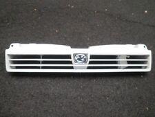 Subaru L Series Leone (87-93) - GRILL.  White. Good condition. With badge.