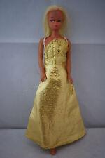 teenage Barbie clone doll blonde hair cat eyes mod 70's