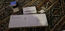 Apple MagSafe 2 85W Power Adapter, Magic Mouse, and One other Accessory
