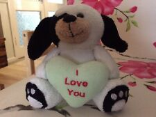 """Soft toy dog holding """"I love you"""" heart"""
