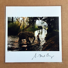 STEVE McCURRY SIGNED PRINT - BOY AND ELEPHANT CROSSING A STREAM - THAILAND, 2010